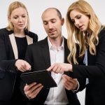 business-persons-watch-tablet-1