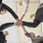 business-team-put-hands-together-1