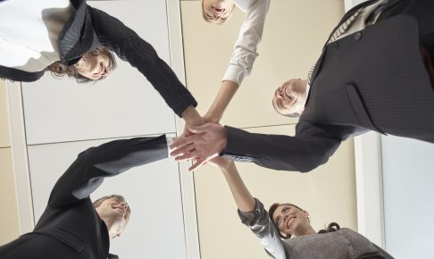 business-team-put-hands-together-1