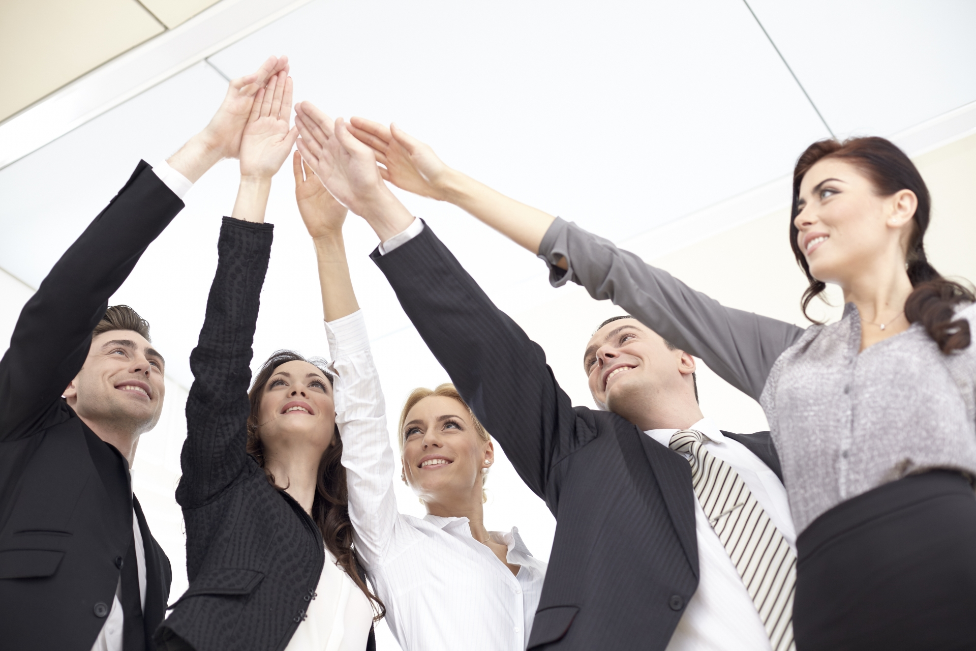 business-team-put-hands-together-2