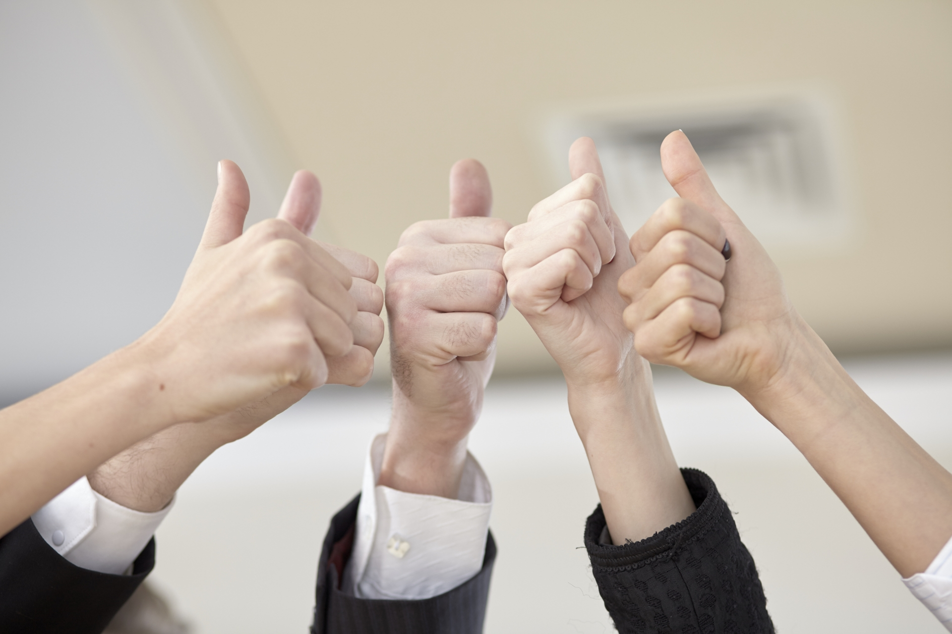business-team-put-thumbs-up-hands-together-1