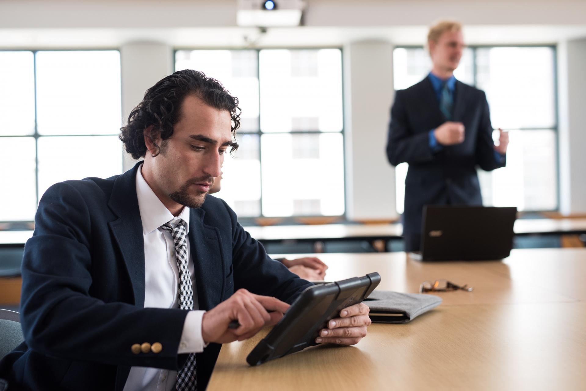 businessman-plays-tablet-1